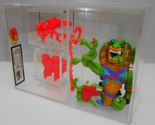 TMNT LOOSE WITH 2 WEAPONS CAPSULES GRADING